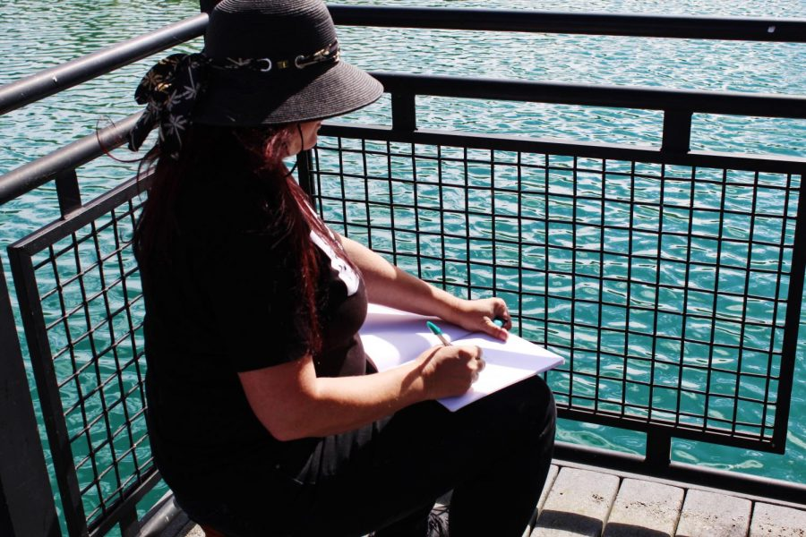Christina Wald of Urban Sketchers watching the performances across Loch Norse.