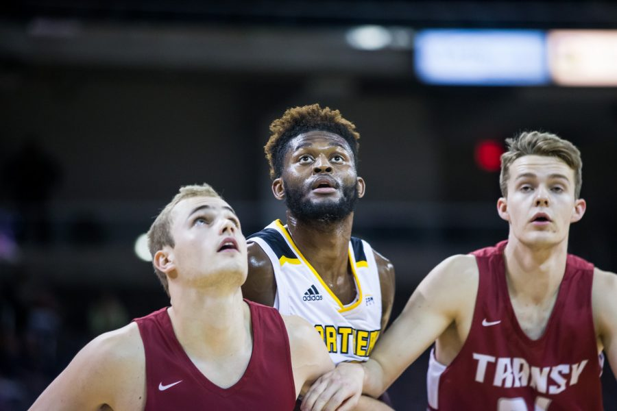 Trevon Faulkner (12) waits for a rebound after a free throw during the game against Transylvania. The Norse defeated Transylvania 71-45.