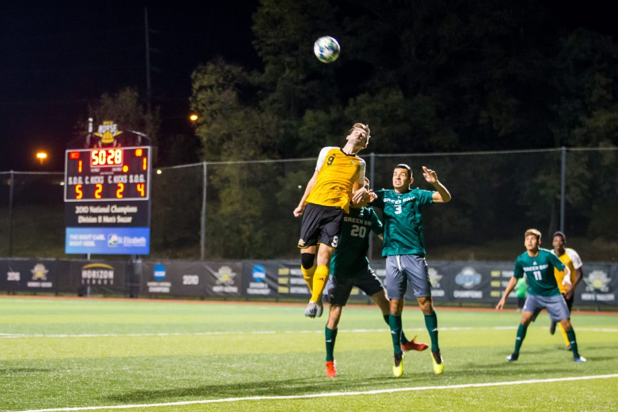 Alex Willis (9) goes up for a head ball during the game against Green Bay. The Norse fell to Green Bay with a final score of 3-2.