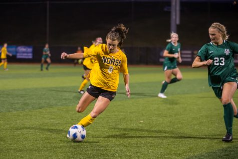 Shawna Zaken (8) drives the ball down the field during the game against Cleveland State. The Norse fall to 2-3 in the conference after the loss to Cleveland State.