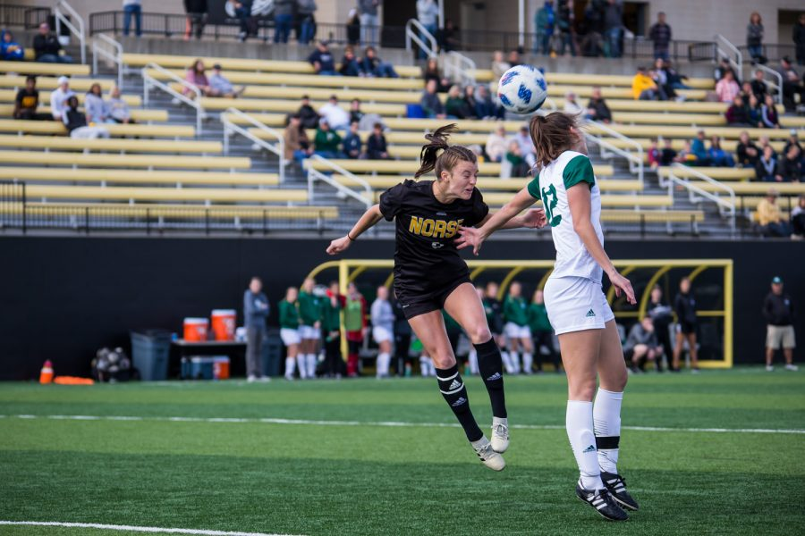Shawna Zaken (8) goes up for a head ball during the game against Green Bay. The Norse defeated Green Bay 5-1 during the game on Sunday afternoon.