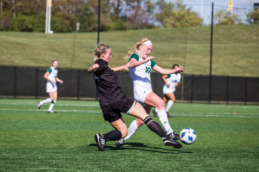 Hannah Fischer (4) defends against a Green Bay player during the game against Green Bay. The Norse defeated Green Bay 5-1 during the game on Sunday afternoon.