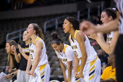 NKU players cheer after a shot during the game against Davis & Elkins College. The Norse defeated Davis & Elkins College 73-47 on the night.