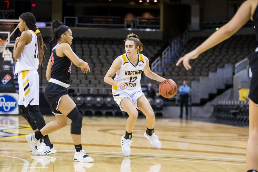 Carissa Garcia (12)  looks to pass during the game against Davis & Elkins College. Garcia shot 7-of-16 and had 16 points on the night.