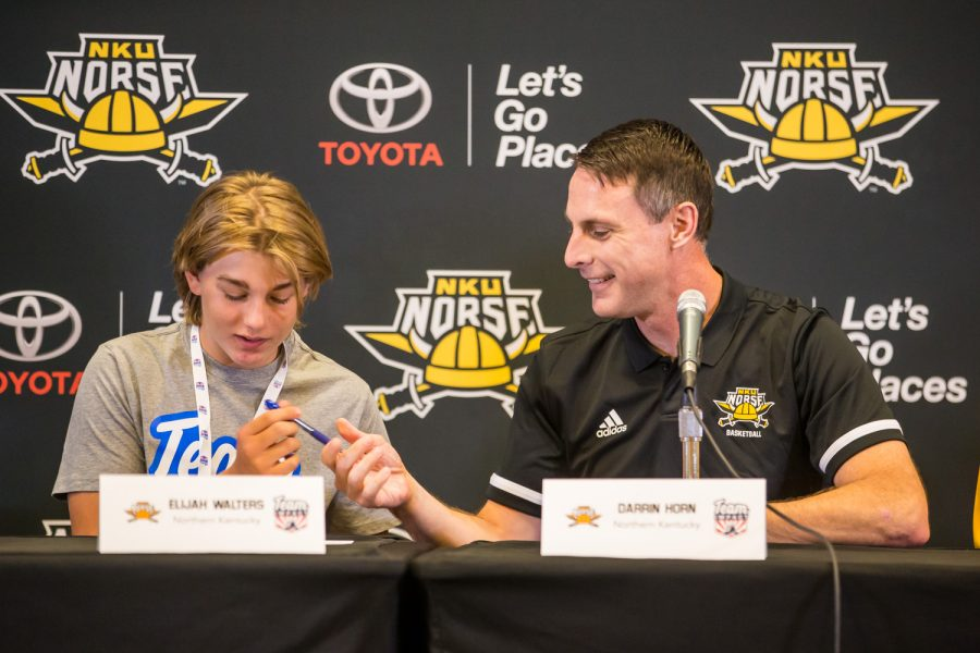 Elijah+Walters+signs+his+letter+of+intent+with+NKU+men%27s+basketball+head+coach+Darrin+Horn.