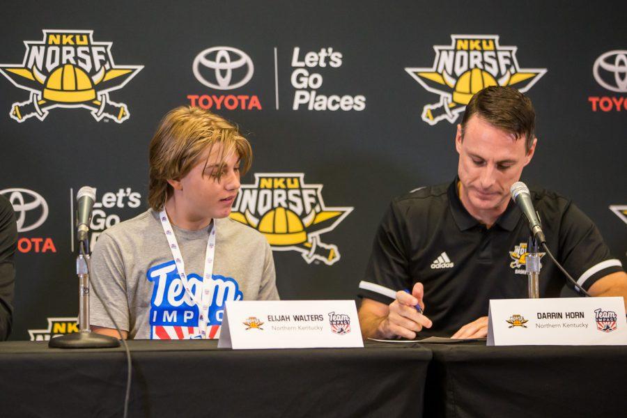Coach Horn signs Elijahs letter of intent.