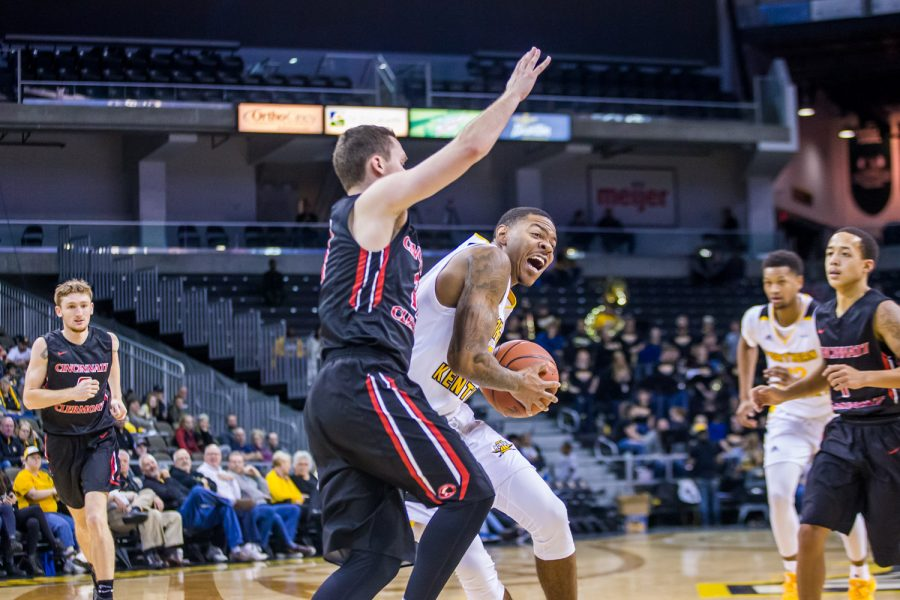 Karl Harris (14) fights to get a shot off during the game against UC Clermont. Harris shot 5-of-6 on the night and had 16 points.