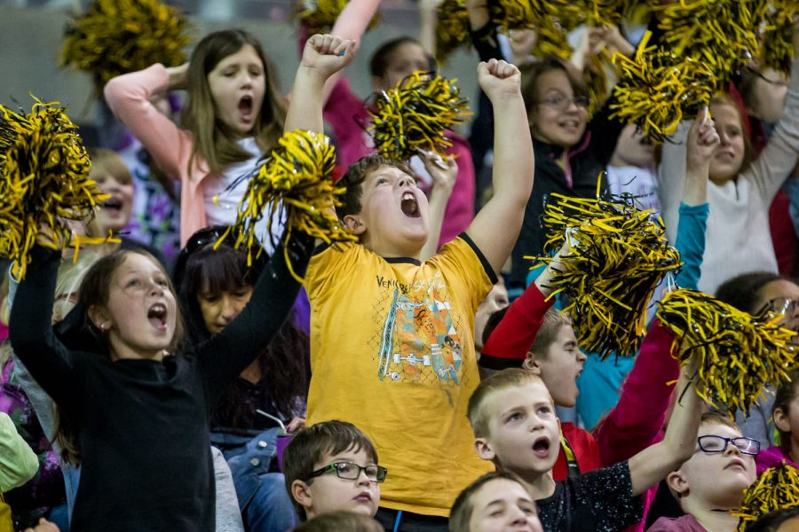Children cheer during the Victor's Hoops 4 Health event held during the Women's Basketball game against the University of Central Arkansas.
