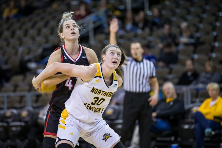 Emmy Souder (30) fights to get a rebound during the game against the University of Nebraska at Omaha. Souder had 5 rebounds on the game and 1 steal.