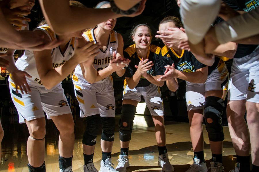 NKU players huddle before the game against Saint Louis University. The Norse fell 67-42 on the night.