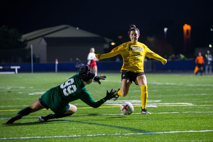 Ally Perkins (6) fights to get a shot past the Detroit Mercy Keeper During the game in Detroit on Friday Night. The Norse Defeated Detroit Mercy 2-0 on the night.