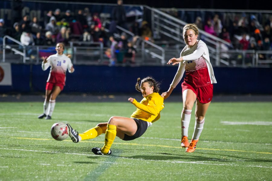 Kiley Keehan (2) falls after being fouled inside the box during the game against Detroit Mercy in Detroit. The Norse were awarded a penalty kick and scored off of it.