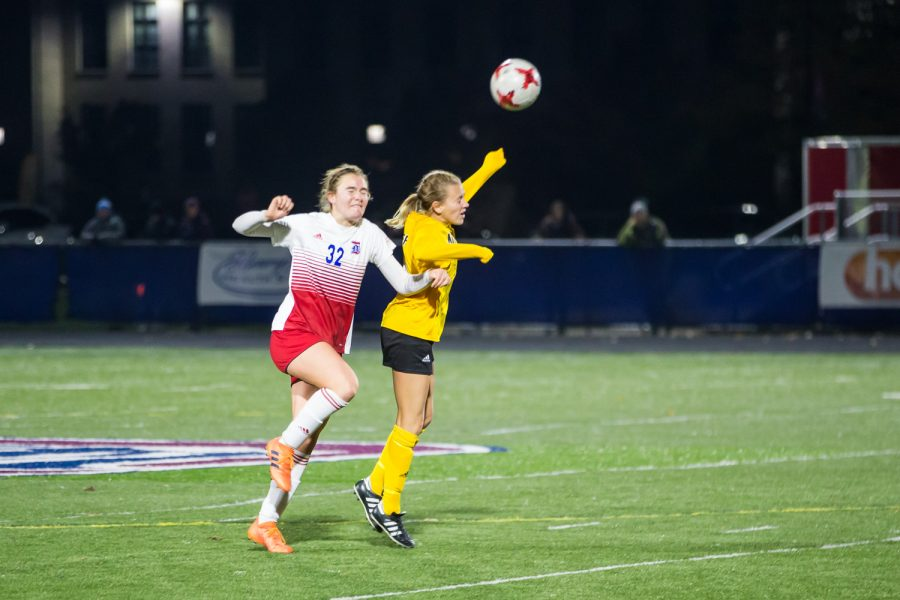Lindsey Meyer (14) goes up for a head ball during the game against Detroit Mercy in Detroit on Friday Night. The Norse Defeated Detroit Mercy 2-0 on the night.