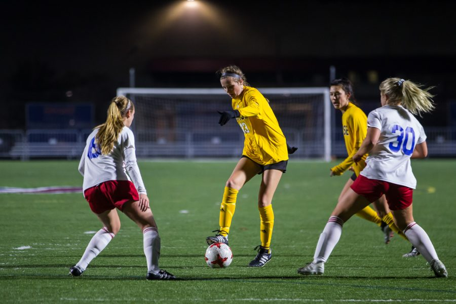 Shelby Wall (13) fights past Detroit defenders during the game against Detroit Mercy in Detroit on Friday Night. The Norse Defeated Detroit Mercy 2-0 on the night.
