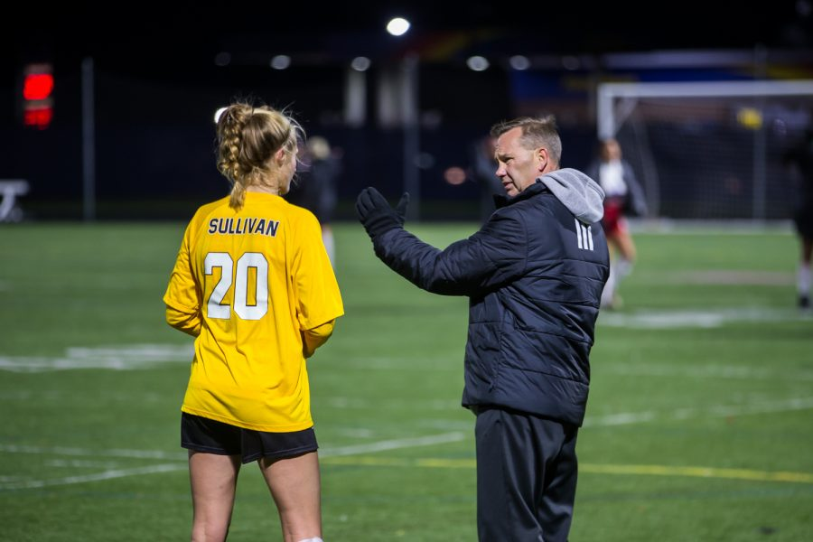 Womens Soccer Head Coach Bob Sheehan Talks to Megan Sullivan (20) during halftime in the game against Detroit Mercy in Detroit on Friday Night. The Norse Defeated Detroit Mercy 2-0 on the night.