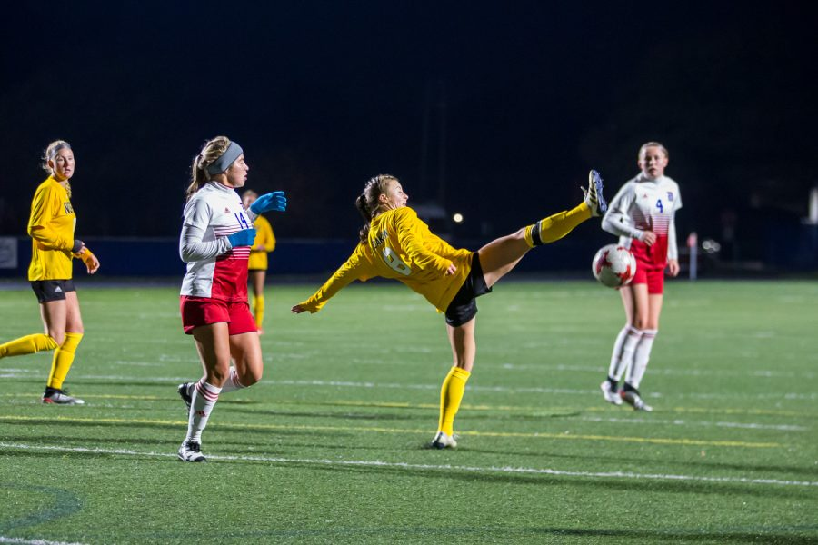 Shawna Zaken (8) fights to reach a ball in the air during the game against Detroit Mercy in Detroit on Friday Night. The Norse Defeated Detroit Mercy 2-0 on the night.