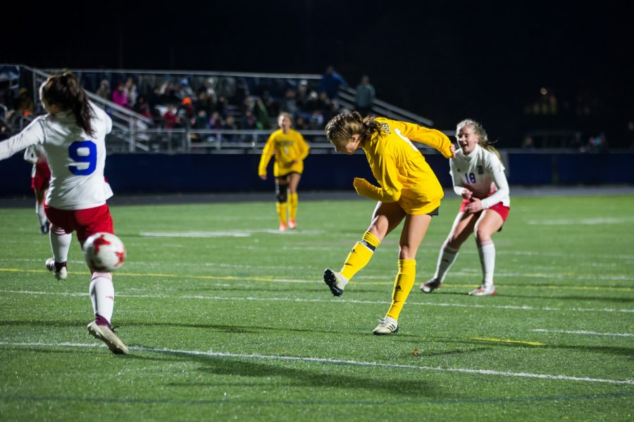 Shawna Zaken (8) shoots during the game against Detroit Mercy in Detroit on Friday Night. Zaken had 2 goals on the night.
