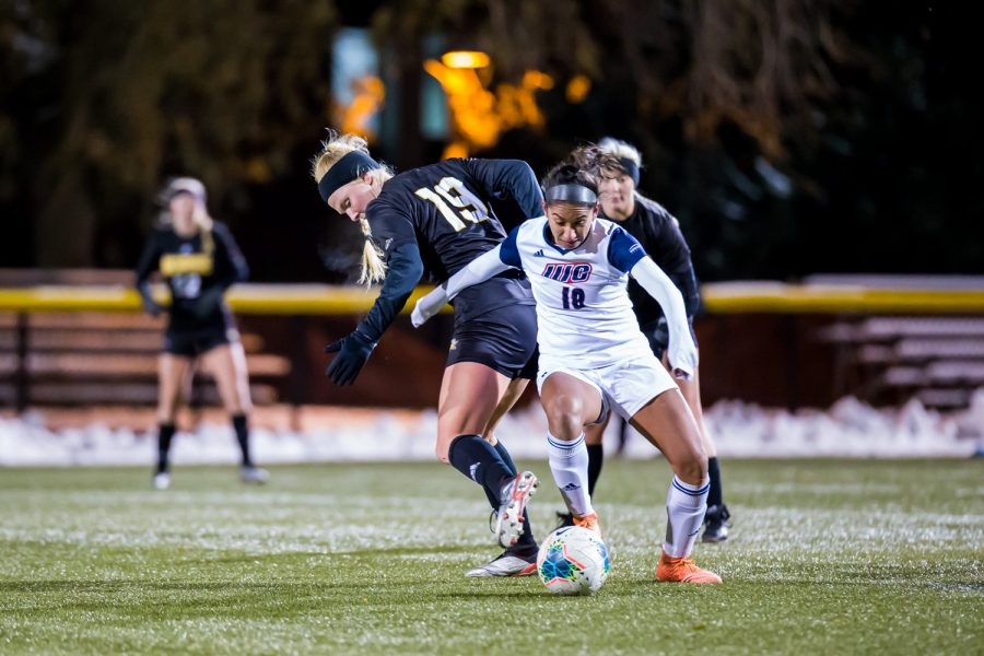 Chloe Mills (19) fights for control of the ball during the semifinal game of the Horizon League Tournament against UIC. The Norse fell to UIC 1-0 in double overtime.