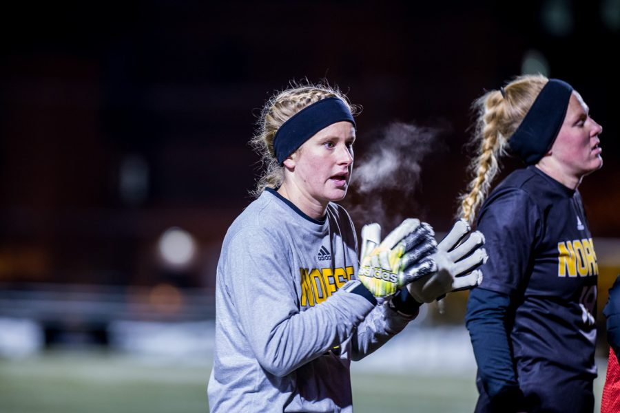 Mimi Stines warms up before the start of the second overtime period during the semifinal game of the Horizon League Tournament against UIC. Stines was credited with 11 saves on the game.
