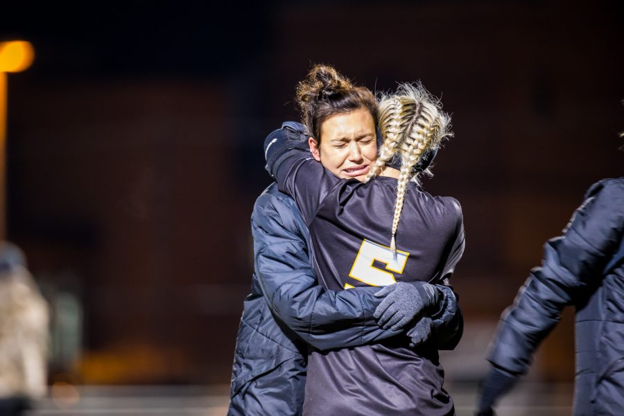 Senior Ally Perkins (6) is comforted by a teammate after the loss in the semifinal game of the Horizon League Tournament in Milwaukee, Wisconsin. The Norse fell in double overtime to the Flames 1-0.