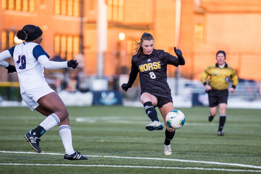 Shawna Zaken (8) passes the ball to a teammate during the semifinal game of the Horizon League Tournament against UIC. The Norse fell to UIC 1-0 in double overtime.