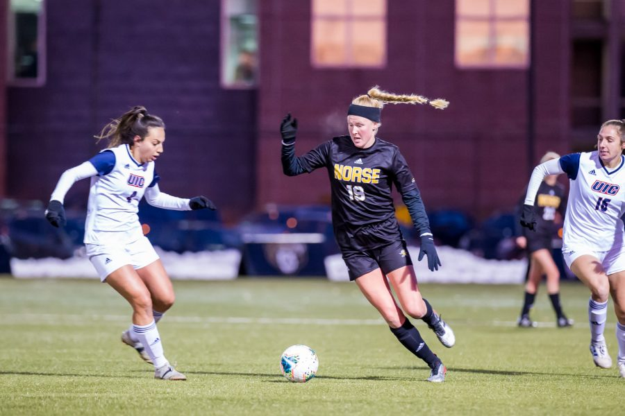 Chloe Mills (19) fights past a UIC defender during the semifinal game of the Horizon League Tournament against UIC. The Norse fell to UIC 1-0 in double overtime.