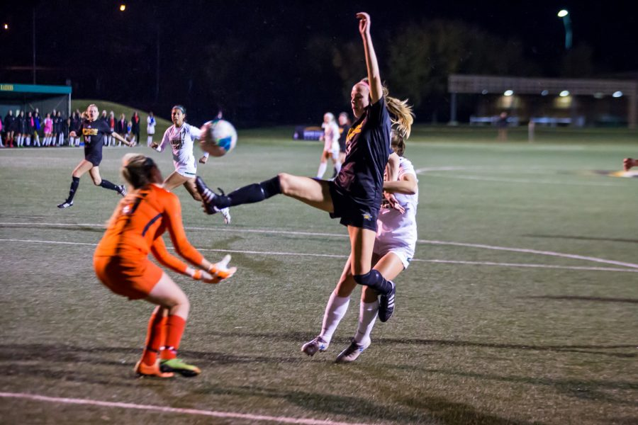 Shelby Wall (13) fights to score off of a ball in the air during the quarter final game of the Horizon League Tournament Against Wright State. The Norse defeated Wright State 3-1 and will advance to the Semi-Final game in Milwaukee.