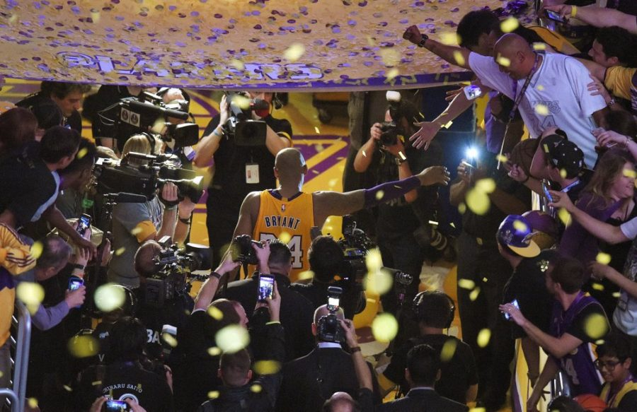 Los Angeles Lakers forward Kobe Bryant walks off the court after finishing his last NBA basketball game before retirement in Los Angeles on April 13, 2016. (AP Photo/Mark J. Terrill)
