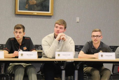 Senators Ryan Brock, Stephen Cordle and Zachary Dichtl listen to Sectary Archer pitches for All Card.
