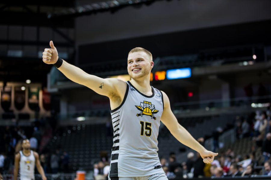 Tyler+Sharpe+%2815%29+smiles+while+walking+off+the+court+after+the+win+against+Youngstown+State.+Sharpe+surpassed+his+1000th+career+point+and+had+33+points+on+the+game.