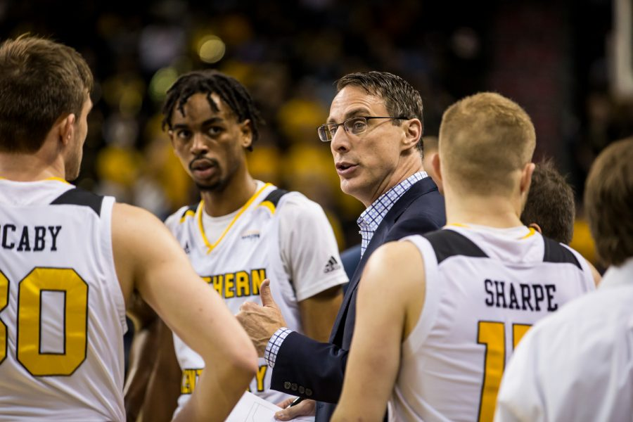 Men's Basketball Head Coach Darrin Horn talks to players during a timeout during the homecoming game against Detroit Mercy.  The Norse defeated Detroit 84-65 on Saturday night.