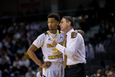 Dantez Walton (32) talks with Men's Basketball Head Coach Darrin Horn  during a free throw during the game against Wright State. The Norse fell to Wright State 64-62 during the final home game of the season.