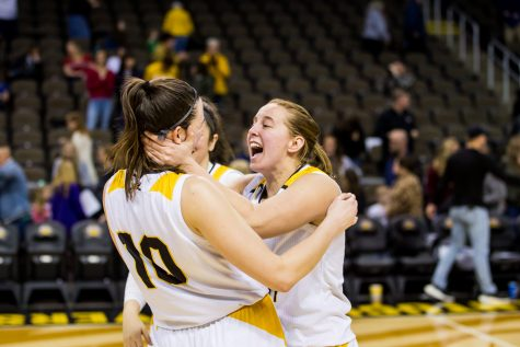 Molly Glick (24) reacts with Grayson Rose (10) following the game against IUPUI. The Norse defeated first ranked team IUPUI 65-62 on Saturday Afternoon.
