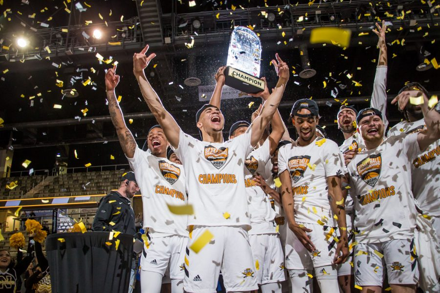 NKU players celebrate on stage moments after their 71-62 win over UIC. With the win the Norse secure a spot in the NCAA Tournament.
