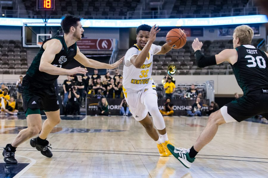 Dantez Walton (32) drives between two Green Bay players during the Semi-Final game of the Horizon League Tournament against Green Bay. The Norse defeated Green Bay 80-69 and move on the face UIC in the final round of the Horizon League Tournament.