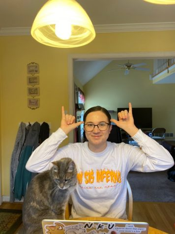 "Junior psychology major Allison Weihe ""Norses Up"" at home."