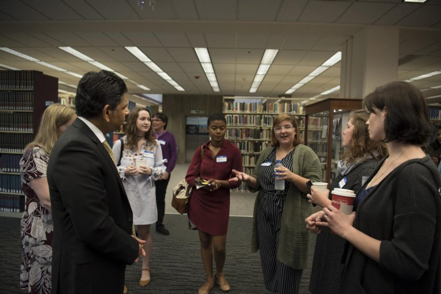 President Ashish Vaidya with members of the English department.