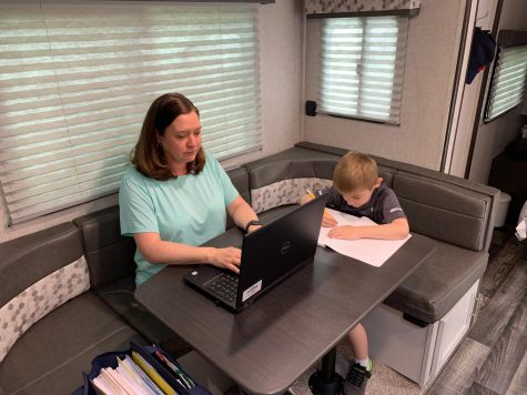 Dr. Jacqueline Emerine and her son working in their converted office trailer.