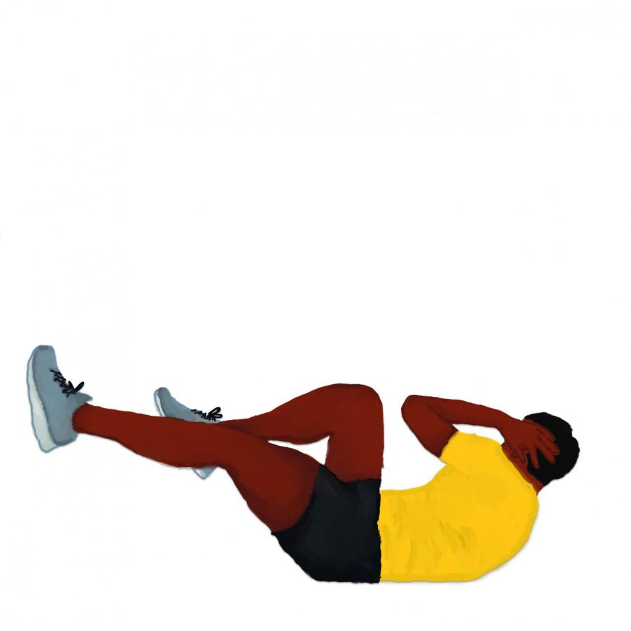 An NKU athlete doing sit ups to stay in shape.