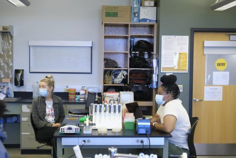 Genetics lab students go over lab etiquette with Assistant Professor Brian Carlson.