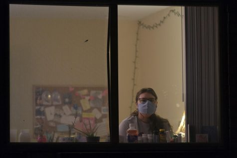 Senior Theatre and Philosophy major Isabel Sleczkowski sits in her apartment where she