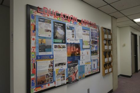 An Education Abroad bulletin board outside their office in University Center room 330.