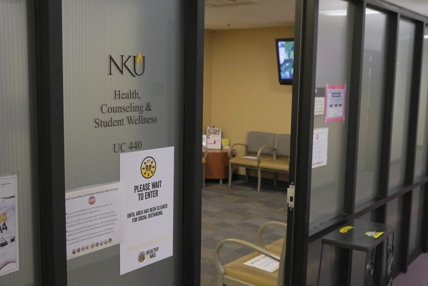 The entrance to Health, Counseling and Student Wellness in University Center. A frosted glass door.