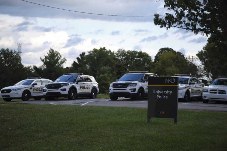 NKU University Police cruiser fleet lined up outside their building on campus.