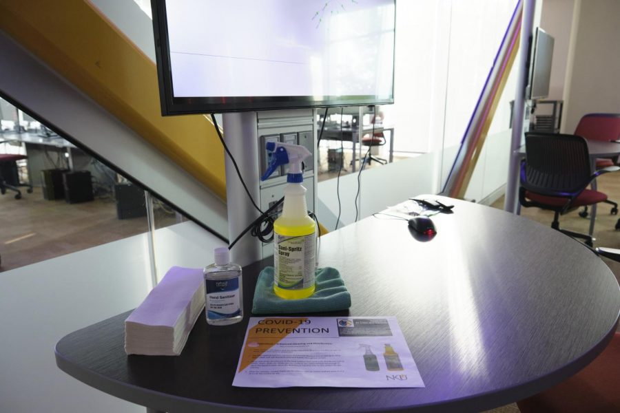 Hand sanitizer and cleaning spray in the JRG Cyber Threat Intelligence Laboratory located in Griffin Hall.