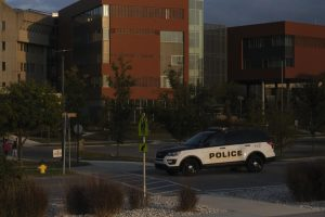 A NKU University Police officer on patrol on Kenton Drive in front of the Health Innovation Center.