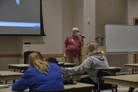 Professor Philip Resnick talks to students before class starts.