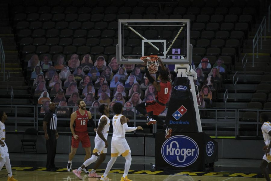 Ball State's Miryne Thomas (0) dunks the ball against NKU.