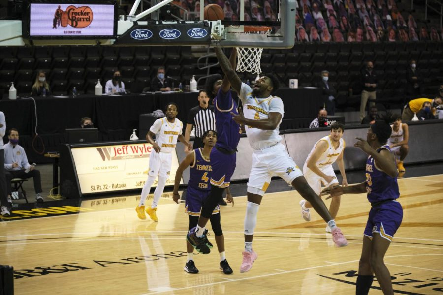 Adrian Nelson (4) lays up a shot against Tennessee Tech. Nelson would finish with 10 points on the night.
