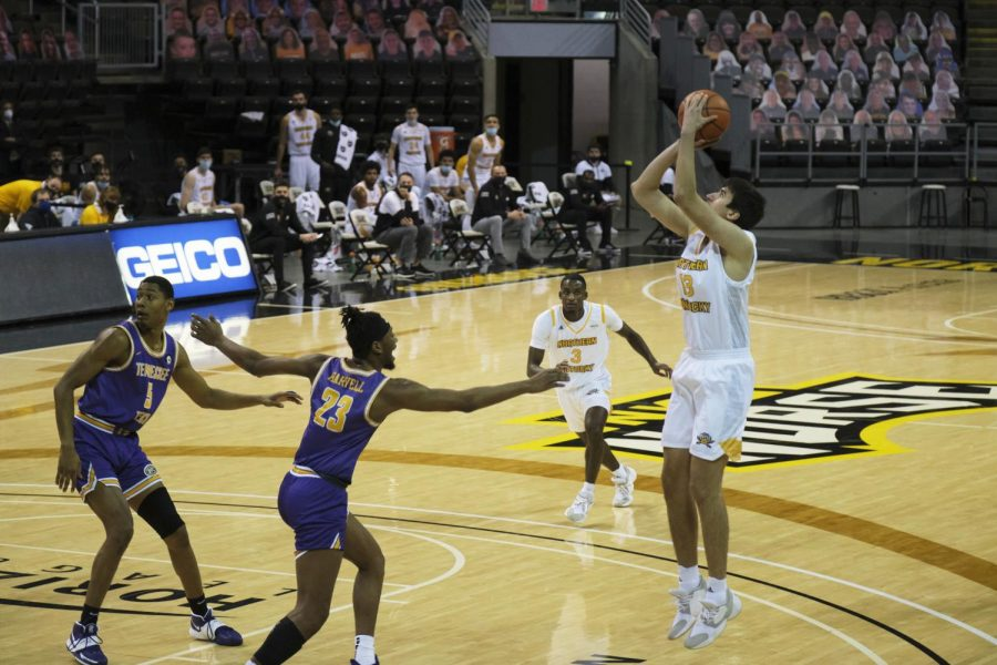 David Böhm (13) shoots a jump shot against Tennessee Tech.